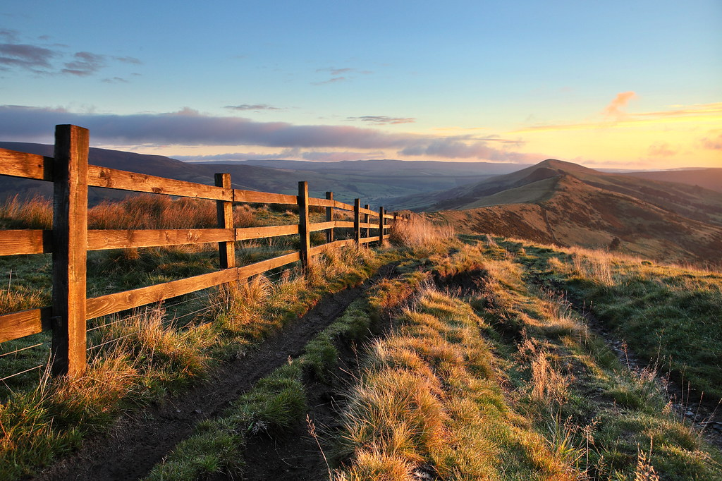 Peak district sunrise, with golden light over mam tor, the ridge and lose hill
