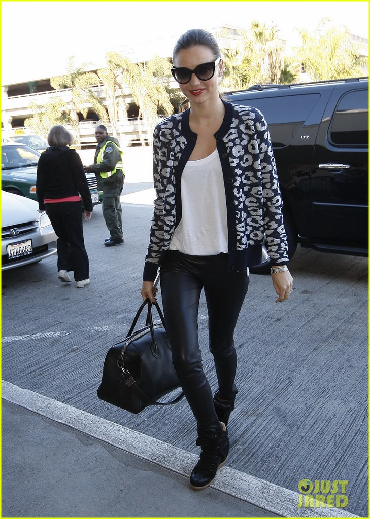 Miranda Kerr Wears Wedge Sneakers To Travel