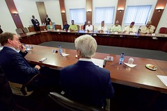 U.S. Secretary of State John Kerry, flanked by U.S. Embassy Abuja Deputy Chief of Mission David Young, sits across from Governors of Nigeria's Northern region at the Presidential Villa in Abuja, Nigeria, on August 23, 2016, before a meeting that followed a bilateral discussion with Nigerian President Muhummadu Buhari. [State Department Photo/ Public Domain]