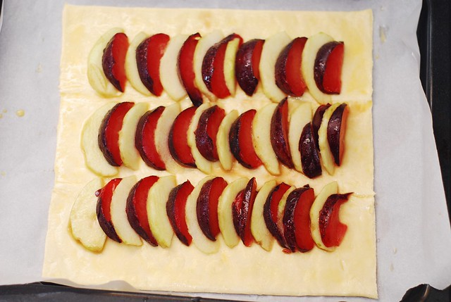 plums and apples on puff pastry sheet 1