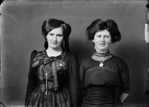 "Tvær konur, á peysufötum og í kjól / Two women, one wearing ""peysuföt"" (traditional Icelandic Costume) and the other a danish dress , 1900-1920"