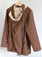 collar(0.0), overcoat(0.0), hood(0.0), brown(1.0), clothing(1.0), sleeve(1.0), khaki(1.0), outerwear(1.0), beige(1.0), jacket(1.0), coat(1.0),