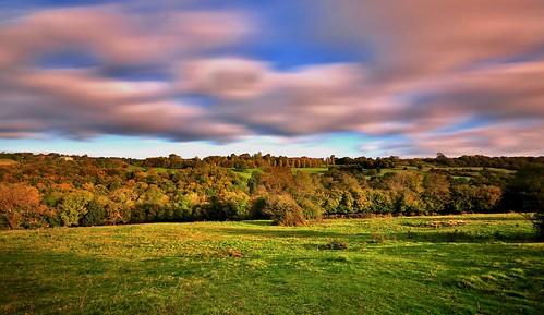 uk longexposure greatbritain blue autumn trees light england sky sun southwest green field clouds rural landscape nikon place britain country sigma bluesky cotswolds gloucestershire hills stroud hdr d90 nd110 lypiatt eastcombe