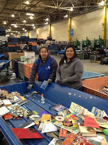 USDA's Vanessa Garcia (Right) gets sorting instruction from a Goodwill employee