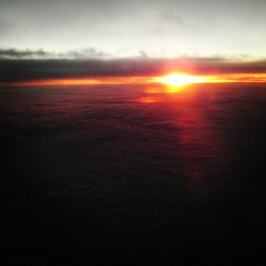 Sunset above a sea of clouds.