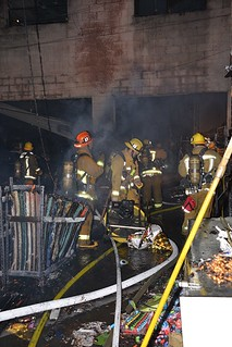 Swift Moving Fire Consumes Los Angeles Party Supply Store. © Photo by Rick McClure, click to view more...