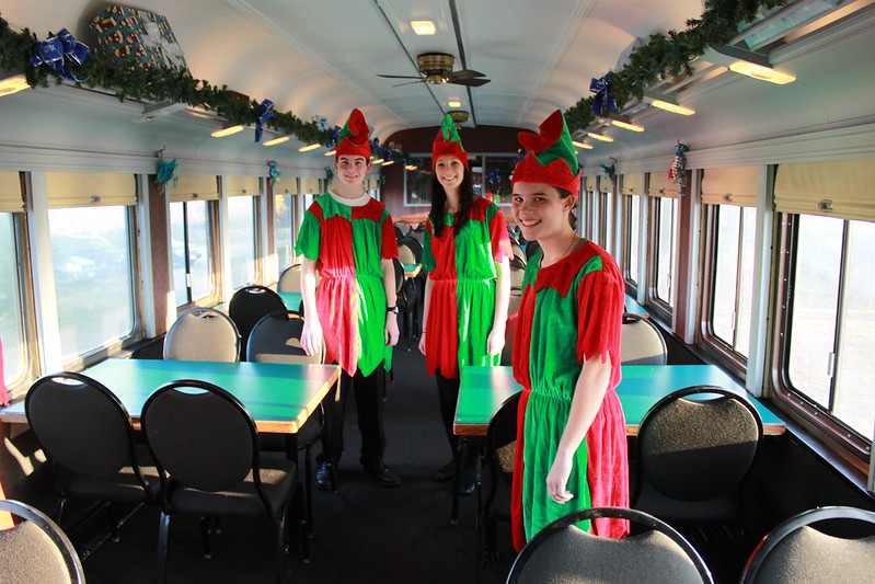 Elves waiting for passengers to board the Polar Express.