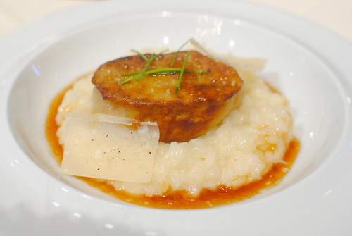 Sauteed duck liver served with a parmesan cheese risotto