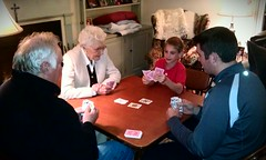 Four generations playing cards