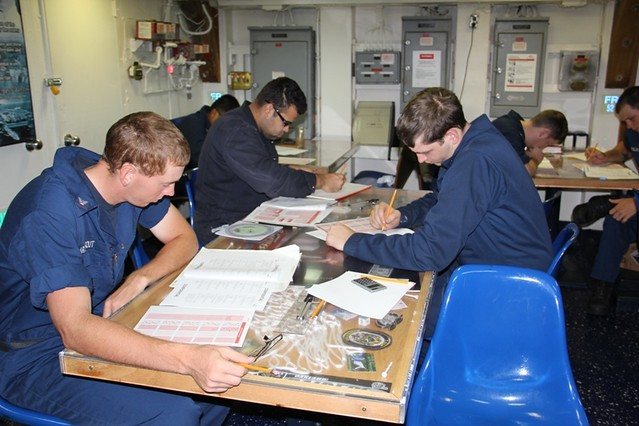 USS Avenger Sailors taking advancement test.