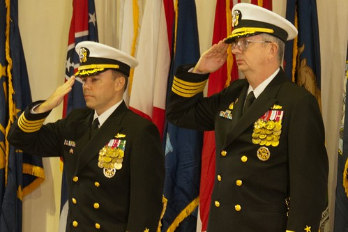 Capt. John L. Schultz (right), outgoing commander of Destroyer Squadron (DESRON) 15, and Capt. Paul Lyons incoming commander