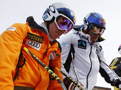 Erik Guay and Aksel Lund Svindal prepare for downhill training in Val Gardena, Italy.