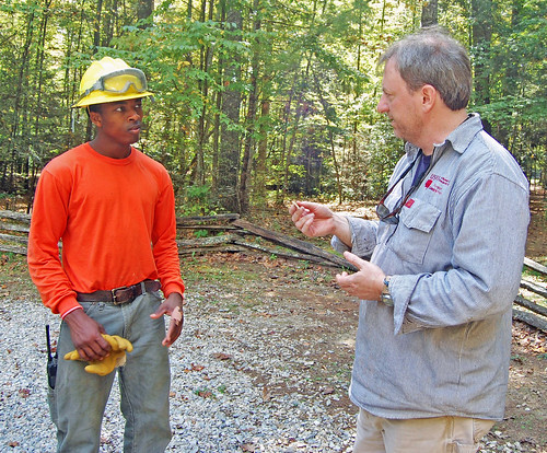 Forest Service Job Corps student Jay Williams learns about pottery found on site from USFS archeologist Andrew Triplett on the Nantahala National Forest on Sept. 29, 2012. As a 0-20 percent slope area, watching for archeological finds was a top priority throughout the project. US Forest Service photo/Holly Krake.