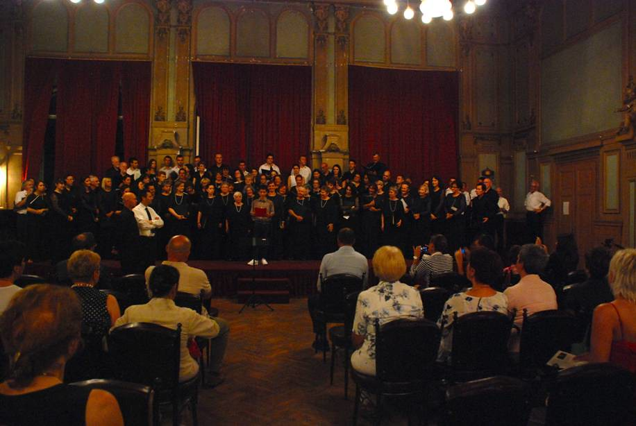 Singing City performs a joint concert with Proleter Choral Society in the Army Hall in Sarajevo, Bosnia