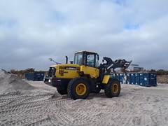 asphalt(0.0), agriculture(0.0), field(0.0), snow removal(0.0), tractor(0.0), vehicle(1.0), transport(1.0), construction equipment(1.0), bulldozer(1.0),