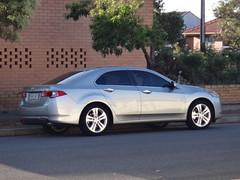 mazda6(0.0), automobile(1.0), automotive exterior(1.0), executive car(1.0), wheel(1.0), vehicle(1.0), rim(1.0), honda(1.0), acura tsx(1.0), sedan(1.0), land vehicle(1.0), luxury vehicle(1.0),