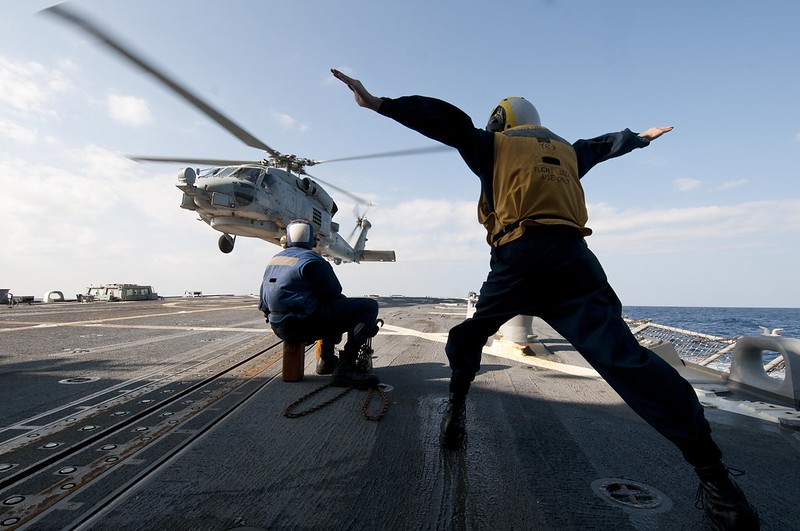 Sailors assigned to USS Mustin conduct flight operations at sea