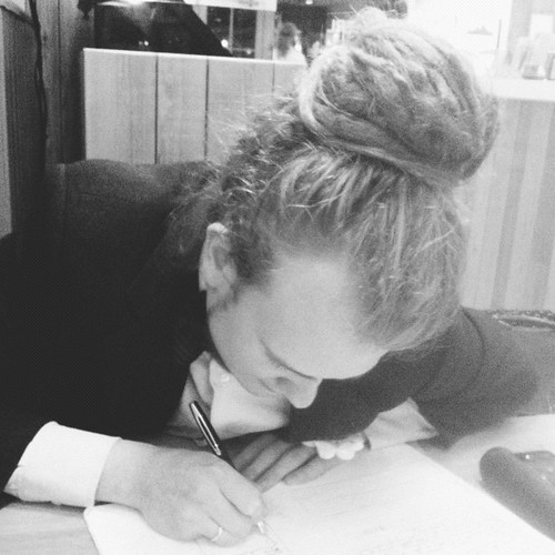 he looks like a school boy when he's writing. ✏
