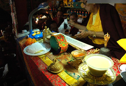 Tea in a jade cup, Buddhist impliments on his table, pecha, mandala offering of the ku, body of the Buddha, His Holiness Jigdal Dagchen Sakya, high lama of the Sakya order, Sakya Lamdre, Tharlam Monastery, Boudha, Kathmandu, Nepal by Wonderlane