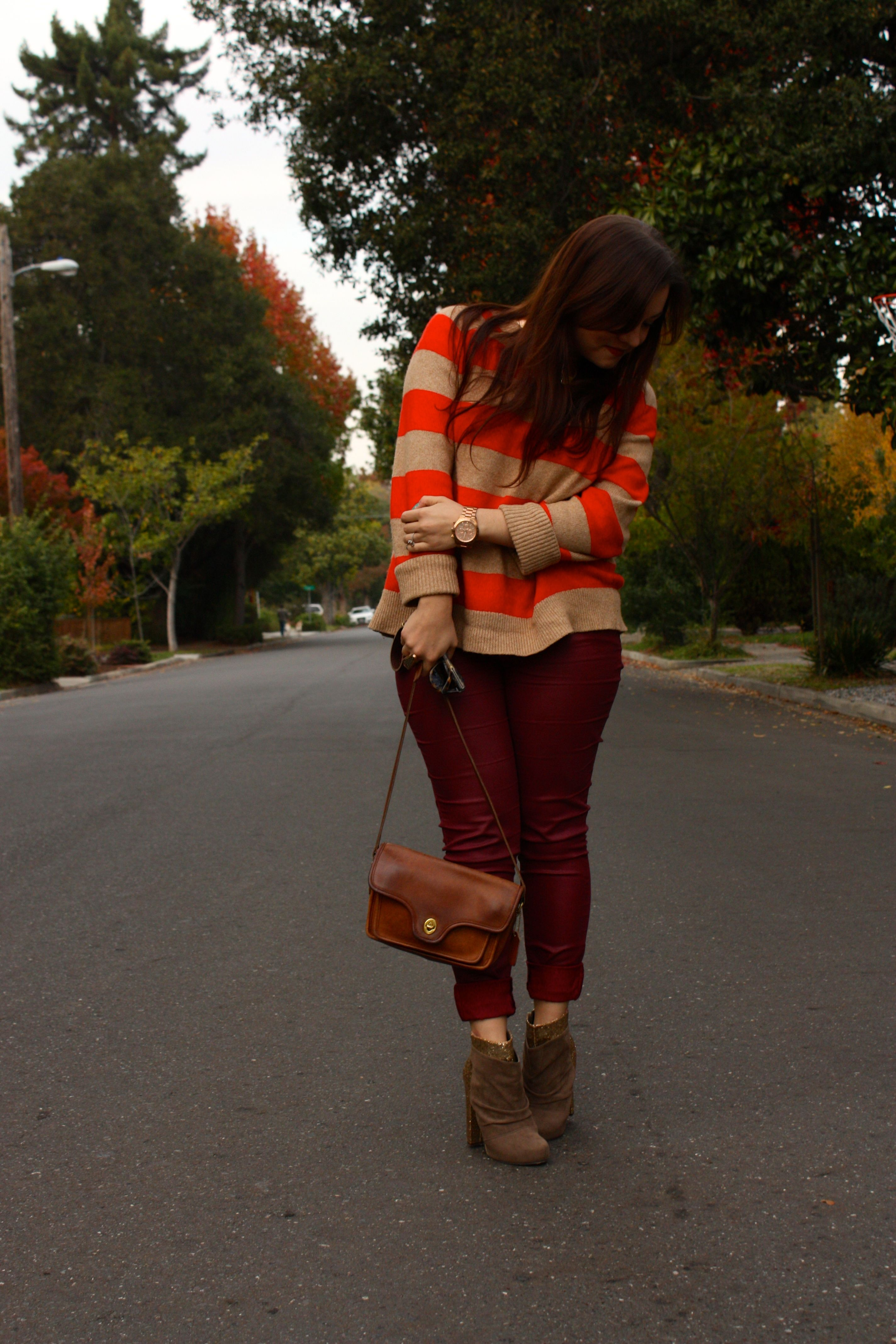 burgundy waxed jeans with orange striped lands end sweater and brown coach bag plus glitter booties09