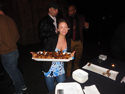 server with tray of bbq spare ribs in the Fermenting Cellar