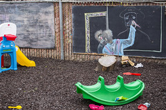 Sad clown and playground