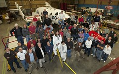 Sir Richard Branson and the Scaled Composites team pose in front of SpaceShipTwo, after Richard got to see for himself the great progress being made installing rocket motor and tanks in preparation for powered flight