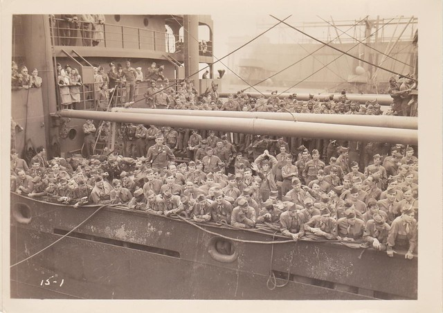 Returning WWII Troops aboard the SS Wheaton Victory in New York Harbor<br> After the war, The Wheaton Victory merchant marine ship was pressed into service as a troop transport ferrying returning service personnel back to the States. The troops crowed the decks as the ship arrived at the docks in New York Harbor sometime in late July 1946 or early August 1946.  In the crowd can be seen servicemen and officers, service women, and African American soldiers. Image courtesy of Colin Smith.