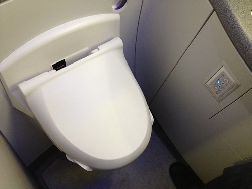 Even on the airplane, a bidet toilet seat