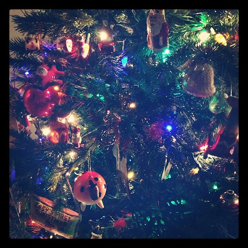 "The tree is up. I love our ornaments, which are about three quarters ""Santa and whimsy,"" as Geoff told Katie tonight. See Fat Horse there in the lower left? Fat Horse makes me happy just by existing."