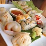 Crab egg rolls, dumplings and sushi