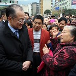 World Bank President Jim Yong Kim talks with people at Yanting County's Nanmen Square