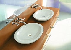 toilet(0.0), bathtub(0.0), toilet seat(0.0), ceramic(0.0), bidet(0.0), floor(1.0), room(1.0), plumbing fixture(1.0), tap(1.0), bathroom(1.0), flooring(1.0), sink(1.0),