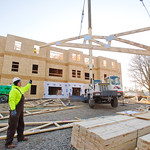 12-068 -- After the first residents of The Gates at Wesleyan signed their names to the final roof truss, the addition of this truss to the construction project marked the completion of the frame structure.