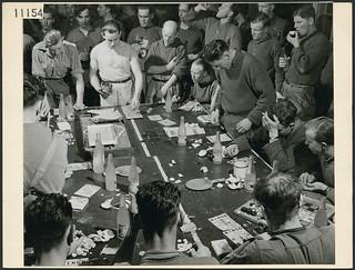 The Lovat Scouts (a British Army unit) participating in the nightly bingo game / Les Lovat Scouts (une unité de l'Armée britannique) participent à la partie de bingo du soir