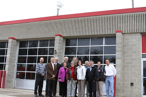 A new storm warning siren has been installed above the fire hall in Lake Benton, Minn. Officials from the USDA and Lincoln County gathered in Lake Benton recently to highlight how USDA funding helped four communities in Lincoln County purchase and install new storm sirens.  Minnesota Rural Development State Director Colleen Landkamer is pictured fourth from the left.