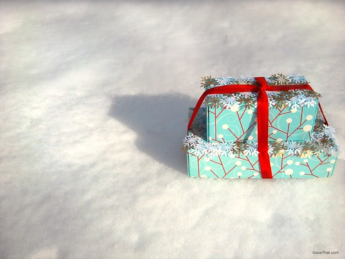 Paper snow capped presents in fresh powder