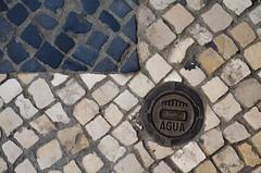 art, sidewalk, cobblestone, manhole, circle, road surface,
