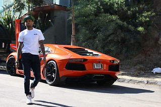 Chris brown showing off his new Lamborghini Aventador