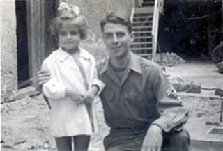 Dietlinde Keidel poses with an American soldier after  World War II. Keidel was 3 years old when the war ended.