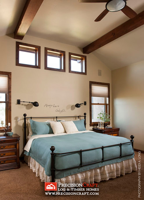 Master Bedroom in this Custom Timber Frame Home by PrecisionCraft