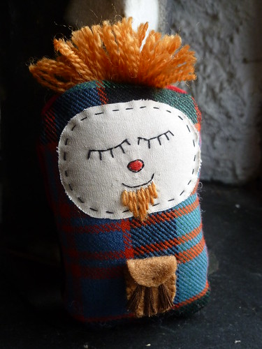 "Jock. He is a little softy about 4"" tall with a pocket on the back in which I can tuck a note."