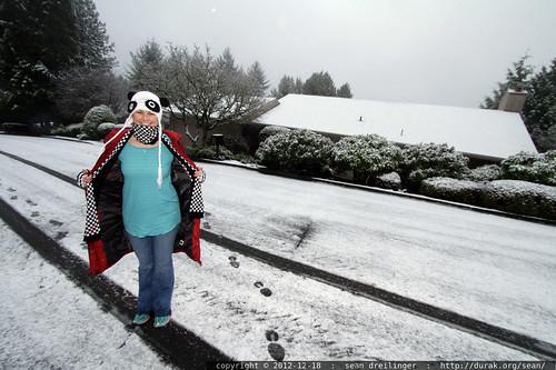 rachel, still wearing pajamas, walking home from school in the falling snow    MG 0601
