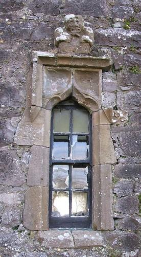 St Munna's church, Taghmon, Westmeath - carved sandstone window with Sheela-na-Gig figure