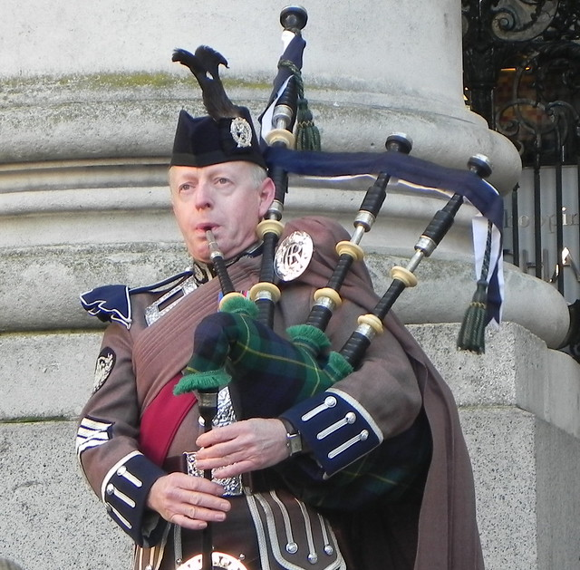 THE PIPER PLAYS AT THE SERVICE