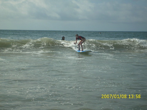 Catching a wave at Playa Tamarindo in Costa Rica