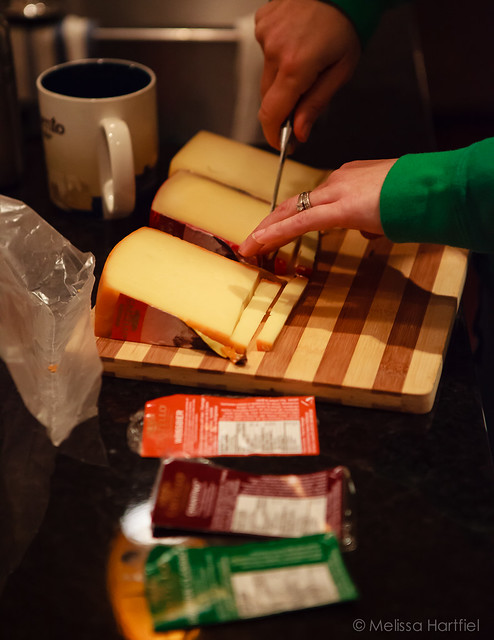 Slicing up cheese for samples