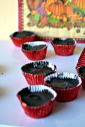 homemade pumpkin peanut butter cups with a fall background