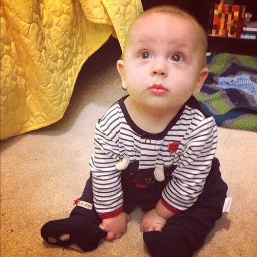Five months! Little cutie is practicing his new skill, sitting up, before bed!