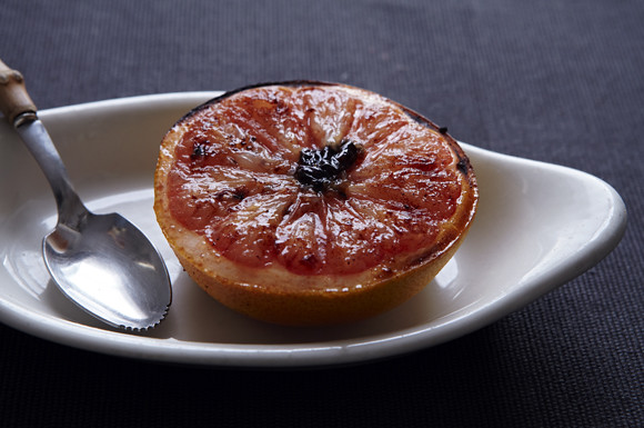 Warm spiced grapefruit stuffed with dried cranberries makes a bright winter breakfast.